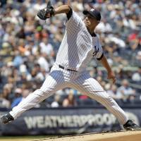 Photo -   New York Yankees starting pitcher Andy Pettitte delivers during the second inning of a baseball game against the Seattle Mariners at Yankee Stadium in New York, Sunday, May 13, 2012. (AP Photo/Seth Wenig)