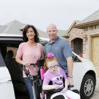 Photo - Brenda and Mike Greene pose with their daughter, Macie, and their new van.  Photo by Doug Hoke, The Oklahoman  DOUG HOKE - THE OKLAHOMAN