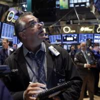 Photo - Trader Kenneth Polcari works on the floor of the New York Stock Exchange Thursday, March 13, 2014. Stocks opened higher as traders were encouraged by a pickup in retail sales and more signs of health in the U.S. job market. (AP Photo/Richard Drew)