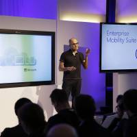 Photo -  Microsoft CEO Satya Nadella talks about the intersection of cloud and mobile computing during a news briefing Thursday in San Francisco.  AP Photo   Eric Risberg -