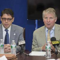 Photo - Manhattan Disctrict Attorney Cyrus Vance, right, speaks alongside New York City Department of Investigation Commissioner Mark Peters during a round table news conference with reporters at the Manhattan District Attorney's offices, Wednesday, July 2, 2014, in New York. Vance announced the indictment of several individuals and businesses on charges including grand larceny, fraud, forgery, and evidence tampering through a building site safety inspection scam. (AP Photo/John Minchillo)