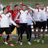 Photo - Germany's players  practice during a training session prior to the international friendly soccer match between Germany and Chile in Stuttgart, southern Germany, Monday, March 3, 2014. Germany will face Chile Wednesday. (AP Photo/Matthias Schrader)