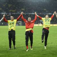 Photo - Switzerland's national soccer team, celebrates after winning the FIFA World Cup 2014 group E qualifying soccer match between Switzerland and Slovenia at the Stade de Suisse stadium in Bern, Switzerland, Tuesday, October 15, 2013. (AP Photo/Keystone/Jean-Christophe Bott)