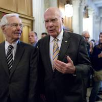 Photo - Sen. Patrick Leahy, D-Vt., president pro tempore of the Senate, right, and Sen. Thad Cochran, R-Miss., left, walk to the floor of the Senate during a vote on legislation  to collect sales tax on Internet purchases, on Capitol Hill in Washington, Monday, May 6, 2013.  (AP Photo/J. Scott Applewhite)