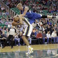 Photo - Minnesota Timberwolves' Chase Budinger (10) fouls Utah Jazz's Richard Jefferson (24) in the first quarter of an NBA basketball game, Feb. 22, 2014, in Salt Lake City. (AP Photo/Rick Bowmer)