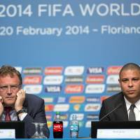 Photo - Ronaldo, right, Brazil's former soccer player and a member of the local organizing committee for the 2014 World Cup, and FIFA Secretary General Jerome Valcke attend a news conference during the Team Workshop for the 2014 World Cup at the Costao do Santinho hotel in Florianopolis, Brazil, Friday, Feb. 21, 2014. Ronaldo was on hand to address the problem with the fanfests, which allows fans without tickets to watch matches for free on large screens in public areas. City officials in the northeastern city of Recife said they will not spend money to hold the fanfest event. (AP Photo/Andre Penner)