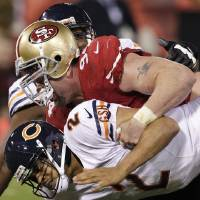 Photo -   Chicago Bears quarterback Jason Campbell (2) is sacked by San Francisco 49ers defensive tackle Justin Smith (94) and linebacker Aldon Smith, not pictured, during the fourth quarter of an NFL football game in San Francisco, Monday, Nov. 19, 2012. The 49ers won 32-7. (AP Photo/Tony Avelar)
