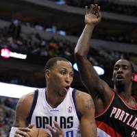 Photo -   Dallas Mavericks' Shawn Marion (0) comes down with a defensive rebound in front of Portland Trail Blazers center J.J. Hickson (21) during the first half of an NBA basketball game, Monday, Nov. 5, 2012, in Dallas. (AP Photo/Tony Gutierrez)