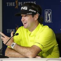 Photo - Bubba Watson answers questions at a news conference after a practice round for The Players championship golf tournament at TPC Sawgrass in Ponte Vedra Beach, Fla., Tuesday, May 6, 2014. (AP Photo/John Raoux)