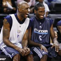 Photo - Joe Smith, left, and Kyle Weaver share a laugh during the open practice for the Oklahoma City Thunder NBA basketball team at the Ford Center in Oklahoma City, Monday, October 20, 2008. BY NATE BILLINGS, THE OKLAHOMAN  ORG XMIT: KOD