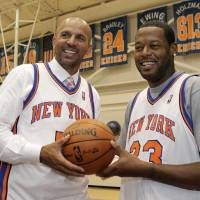 Photo -   Jason Kidd, left, and Marcus Camby pose for a photograph following a news conference to introduce the New York Knicks newest additions at the team's NBA basketball training facility in Tarrytown, N.Y., Thursday, July 12, 2012. This is Camby's second stint as a member of the Knicks. (AP Photo/Kathy Willens)