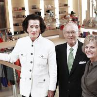 Photo - Lolly Sweeney, left, poses with Balliets owners Bob and DeDe Benham. Sweeney, 87, recently celebrated her 67th year with the store. Photo by Jim Beckel, The Oklahoman