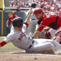 Photo - Boston Red Sox' Daniel Nava, left, scores in front of Cincinnati Reds catcher Devin Mesoraco, right, after a Mike Napoli ground ball in the first inning of a baseball game, Wednesday, Aug. 13, 2014, in Cincinnati. (AP Photo/David Kohl)