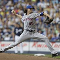 Photo - New York Mets starting pitcher Jacob Degrom throws to the Milwaukee Brewers during the first inning of a baseball game Sunday, July 27, 2014, in Milwaukee. (AP Photo/Jeffrey Phelps)