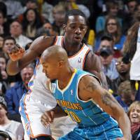 Photo - Oklahoma City's Jeff Green (22) defends David West (30) of New Orleans during the NBA basketball game between the New Orleans Hornets and the Oklahoma City Thunder at the Oklahoma City Arena in downtown Oklahoma City, Monday, Nov. 29, 2010. Photo by Nate Billings, The Oklahoman
