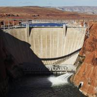 Photo -   The high-flow release of water into the Colorado River from bypass tubes at Glen Canyon Dam in Page, Ariz., Monday Nov. 19, 2012 begins as Interior Secretary Ken Salazar opens the valves. Federal water managers started a 5-day high-flow experimental release to help restore the Grand Canyon's ecosystem. (AP Photo/The Arizona Republic,Rob Schumacher) MARICOPA COUNTY OUT; MAGS OUT; NO SALES