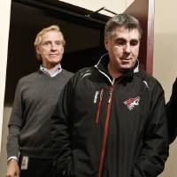 Photo - Phoenix Coyotes' general manager Don Maloney, left, and head coach Dave Tippett arrive at a news conference to talk about the upcoming NHL hockey season, Thursday, Jan. 10, 2013, Glendale, Ariz.(AP Photo/Ross D. Franklin)