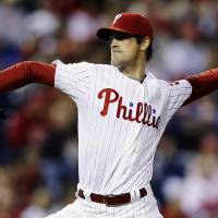 Photo -   Philadelphia Phillies' Cole Hamels pitches in the third inning of a baseball game against the Washington Nationals, Tuesday, Sept. 25, 2012, in Philadelphia. (AP Photo/Matt Slocum)