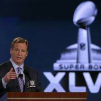 Photo - NFL Commissioner Roger Goodell answers questions during an NFL Super Bowl XLVII football game news conference at the New Orleans Convention Center, Friday, Feb. 1, 2013. in New Orleans. (AP Photo/Charlie Riedel)