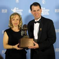 Photo - Janis Teegins, wife of the late Bill Teegins, poses for a photo with Dave Hunziker, the winner of the Bill Teegins Excellence in Sportscasting Award. Photo by Bryan Terry, The Oklahoman