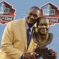 Photo - Hall of Fame Inductee Derrick Brooks poses with his bust during the 2014 Pro Football Hall of Fame Enshrinement Ceremony at the Pro Football Hall of Fame Saturday, Aug. 2, 2014, in Canton, Ohio. (AP Photo/Tony Dejak)