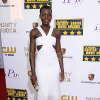 Photo - FILE - This Jan. 16, 2014 file photo shows actress Lupita Nyong'o in a white gown at the 19th annual Critics' Choice Movie Awards in Santa Monica, Calif. (Photo by Jordan Strauss/Invision/AP, FIle)