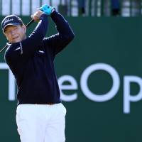 Photo - Tom Watson of the US plays a shot off the 1st  tee during the first day of the British Open Golf championship at the Royal Liverpool golf club, Hoylake, England, Thursday July 17, 2014. (AP Photo/Jon Super)