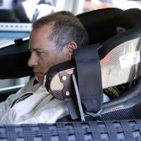 Photo - Jacques Villeneuve, of Canada, prepares to take practice laps for the NASCAR Sprint Cup Series auto race on Friday, June 21, 2013, in Sonoma, Calif. (AP Photo/Ben Margot)