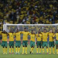 """Photo - FILE-In this file photo taken Saturday, Feb. 2, 2013. South Africa players look on during a penalty shoot-out in their African Cup of Nations quarterfinal soccer match against Mali, at Moses Mabhida Stadium in Durban, South Africa. Now, South Africa is nowhere _ not even among the 31 teams that qualified for this year's World Cup in Brazil. Well, not exactly nowhere. It is on FIFA's radar for an investigation into match-fixing allegations. And it is still in the news at home _ for the wrong reasons: Sports minister Fikile Mbalula last month called the national side """"a bunch of losers"""" and """"useless, unbearable individuals"""" after early elimination on home soil from the lower-level African Nations Championship. (AP Photo/Rebecca Blackwell, File)"""