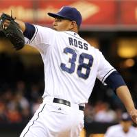 Photo - San Diego Padres starting pitcher Tyson Ross delivers in the first inning of a baseball game against the San Francisco Giants, Friday, April 18, 2014, in San Diego. (AP Photo/Don Boomer)
