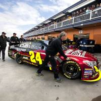 Photo - Pit crew members push Jeff Gordon's car for a template check before the start of qualifying for the NASCAR Sprint Cup Series auto race, Friday, March 8, 2013 in Las Vegas. (AP Photo/Julie Jacobson)