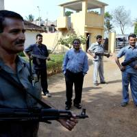 Photo - FILE – In this April 15, 2007 file photo, Mahendra Karma, center, lawmaker and founder of Salwa Judum, the government-supported militia to combat Communist rebels known as Naxalites, is surrounded by bodyguards at his residence in Jagdalpur, in the central Indian state of Chattisgarh. Karma was killed when Maoist rebels attacked a convoy of cars of Congress party leaders and supporters in eastern India, injuring several people on Saturday, May 25, 2013. The rebels have been fighting the central government for more than four decades, demanding land and jobs for tenant farmers and the poor. (AP Photo/Mustafa Quraishi, File)