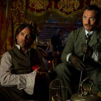 """Photo -  In this image released by Warner Bros. Pictures, Robert Downey Jr., left, and Jude Law, are shown in a scene from """"Sherlock Holmes: A Game of Shadows."""" (AP Photo/Warner Bros. Pictures, Christopher Raphael) ORG XMIT: NYET217"""