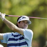 Photo - Bubba Watson drives on the second tee at the final round of the Northern Trust Open golf tournament at Riviera Country Club in the Pacific Palisades area of Los Angeles, Sunday, Feb. 16, 2014.  (AP Photo/Reed Saxon)