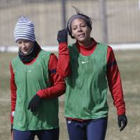 Photo - In this photo made Tuesday, Jan. 28, 2014, U.S. women's soccer team player Sydney Leroux, right, walks with teammate Megan Rapinoe after practice in Frisco, Texas. The U.S. women's soccer team opens its season against Canada in Texas on Friday, Jan. 31, their second meeting since the 2012 Olympic match. (AP Photo)