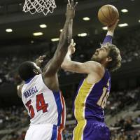 Photo - Los Angeles Lakers forward Pau Gasol (16) of Spain shoots over Detroit Pistons forward Jason Maxiell (54) during the first quarter of an NBA basketball game at the Palace of Auburn Hills, Mich., Sunday, Feb. 3, 2013. (AP Photo/Carlos Osorio)