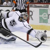 Photo - Los Angeles Kings goalie Jonathan Quick (32) can't stop a San Jose Sharks center Joe Thornton (19) score during the first period in Game 6 of their second-round NHL hockey Stanley Cup playoff series in San Jose, Calif., Sunday, May 26, 2013. (AP Photo/Tony Avelar)