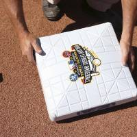 Photo - A base with a commemorative logo is placed on the diamond as preparations are made for the Major League Baseball opening game between the Los Angeles Dodgers and the Arizona Diamondbacks at the Sydney Cricket ground in Sydney, Saturday, March 22, 2014.  (AP Photo/Rick Rycroft)