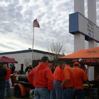 Photo - Cowboys fans gather around the Kingfisher tailgate during the Bedlam Tailgating Showdown.  DAVE CATHEY - THE OKLAHOMAN