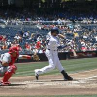 Photo - San Diego Padres' Rene Rivera connects for a bloop single with the bases loaded in the first inning of a baseball game against the Cincinnati Reds Wednesday, July 2, 2014, in San Diego. All three men on base scored on the hit.  (AP Photo/Lenny Ignelzi)
