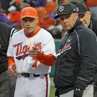 Photo - Clemson head coach Jack Leggett, left, goes over the ground rules with South Carolina head coach Chad Holbrook before their NCAA college baseball game at Doug Kingsmore Stadium, Friday, March 1, 2013, in Clemson, S.C. (AP Photo/Anderson Independent-Mail, Mark Crammer)  GREENVILLE NEWS OUT, SENECA NEWS OUT