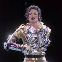 Photo - FILE - In this Dec. 8, 1996 file photo, Michael Jackson belts out a song during the first concert of his 2-days concert tour in Manila, dubbed as HIStory World tour. Accounting expert Arthur Erk told a jury on Monday, July 15, 2013, that Jackson would have likely earned at least $1.1 billion if he completed a worldwide tour and crafted a Las Vegas show before dying. Erk's testimony in a lawsuit filed by the singer's mother, Katherine Jackson, against concert promoter AEG Live LLC, includes estimates that Jackson would have spent $134 million before retiring from showbiz at age 65.  (AP Photo/Pat Roque, File)