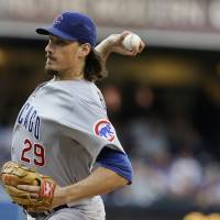 Photo - Chicago Cubs starting pitcher Jeff Samardzija works against the San Diego Padres in the first inning of a baseball game, Saturday, Aug. 24, 2013, in San Diego. (AP Photo/Lenny Ignelzi)