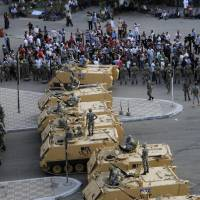 Photo -   Armored Egyptian military vehicles block the road outside of the Ministry of Defense in Cairo, Egypt, Friday, May 4, 2012. Egyptian armed forces and protesters clashed in Cairo on Friday, with troops firing water cannons and tear gas at demonstrators who threw stones as they tried to march on the Defense Ministry, a flashpoint for a new cycle of violence only weeks ahead of presidential elections.(AP Photo/Ahmed Hammad)