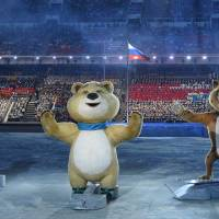 Photo - The 2014 Winter Olympic games official mascots, the Leopard, the Polar Bear, and the Hare, perform during the opening ceremony of the 2014 Winter Olympics in Sochi, Russia, Friday, Feb. 7, 2014. (AP Photo/Lionel Bonaventure, Pool)