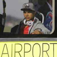 Photo - United States' national soccer team player DeAndre Yedlin arrives at the Sao Paulo International airport in Brazil, Monday, June 9, 2014. The U.S. team arrived in Sao Paulo to continue their preparations for the upcoming Brazil 2014 World Cup, which starts on June 12. (AP Photo/Nelson Antoine)