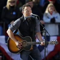 Photo -   Singer Bruce Springsteen performs before the start of a campaign event for President Barack Obama near the State Capitol Building in Madison, Wis., Monday, Nov. 5, 2012. (AP Photo/Pablo Martinez Monsivais)