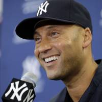 Photo - New York Yankees shortstop Derek Jeter smiles during a news conference Wednesday, Feb. 19, 2014, in Tampa, Fla. Jeter has announced he will retire at the end of the 2014 season. (AP Photo/Chris O'Meara)