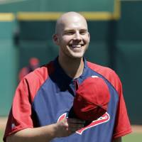 Photo - Cleveland Indians pitcher Justin Masterson tips his hat to fans singing