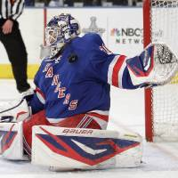 Photo -   New York Rangers goalie Henrik Lundqvist, of Sweden, makes a save on a shot by the Ottawa Senators during the first period of Game 7 of a first-round NHL hockey Stanley Cup playoff series on Thursday, April 26, 2012, in New York. (AP Photo/Julio Cortez)